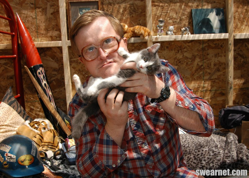 Bubbles and his kitten play in the shed