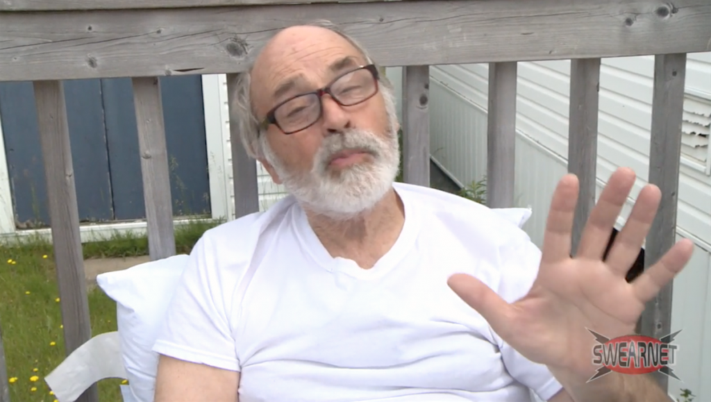 Lahey sitting outside his trailer