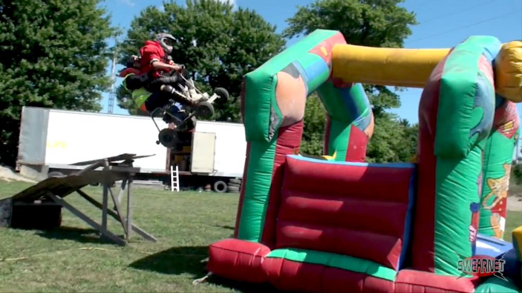 Crazy tandem jump into a bouncy castle!