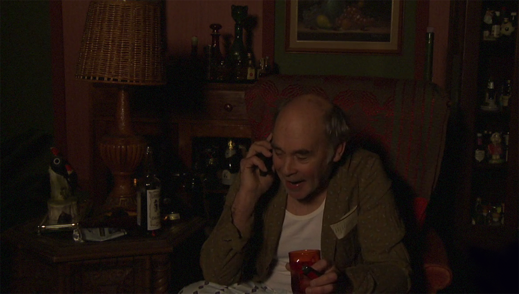 Lahey answers a call during a late-night Liquor Stories taping