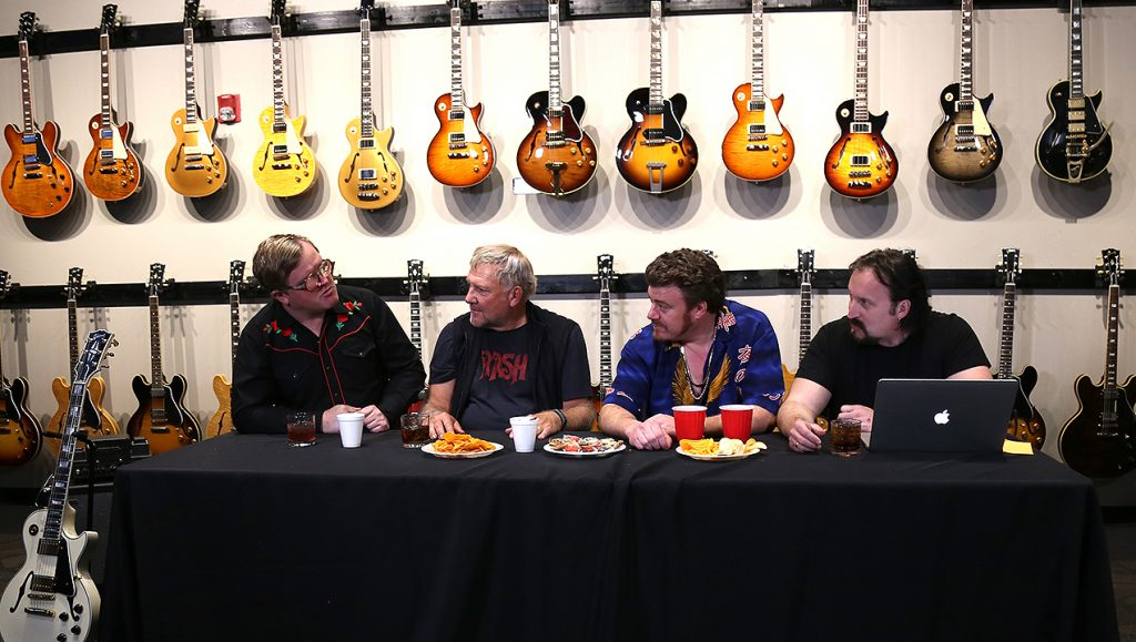 The Trailer Park Boys chat with Alex Lifeson in front of a wall of guitars