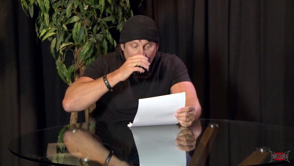 Julian takes a sip of rum