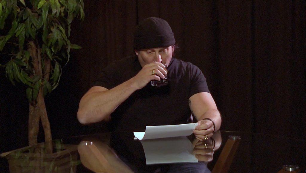 Julian sips on rum and reads fan questions