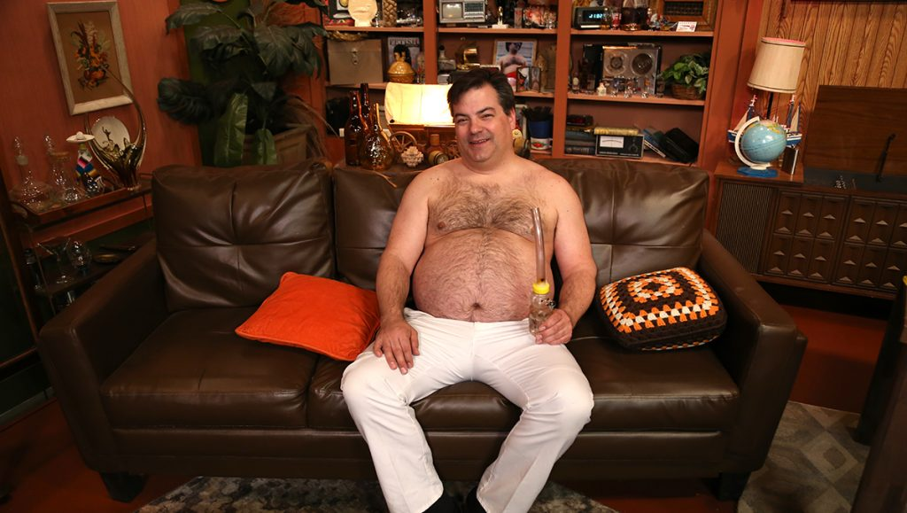 Randy sits on the couch, ready to answer anything!