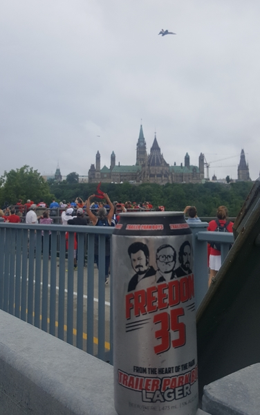 a can of Freeom 35 lager sits in Ottawa as a fighter jet flies over Parliament Hill