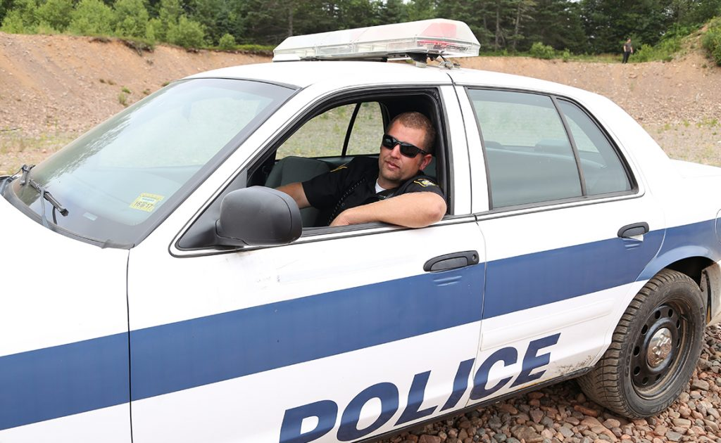 Transportation Co-ordinator Shawn Murphy tests out a Sunnyvale Police Cruiser.
