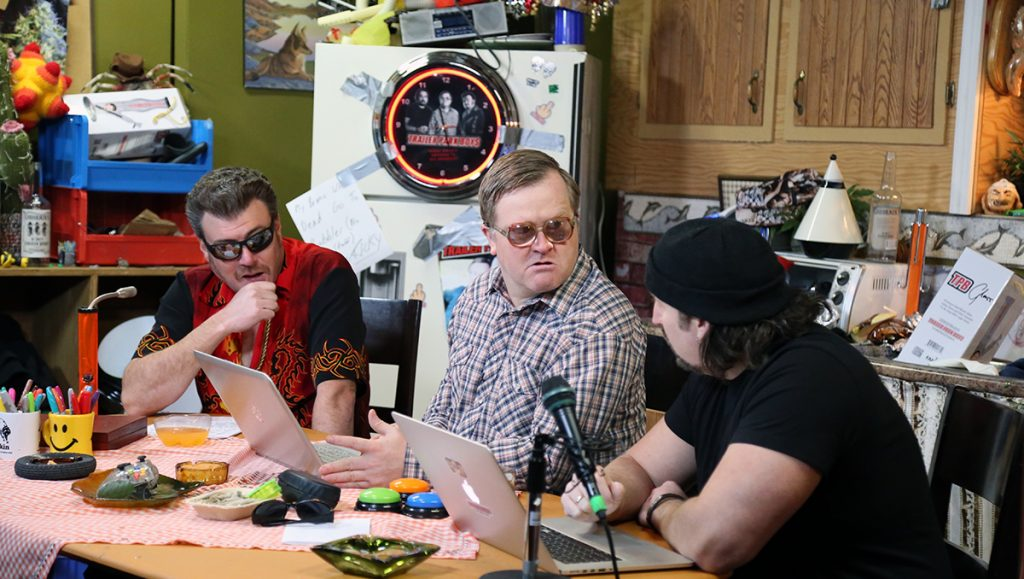 Ricky, Julian, and Bubbles are at the podcast table